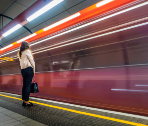 single-woman-waiting-on-the-platform-for-her-train-LJVZUP3